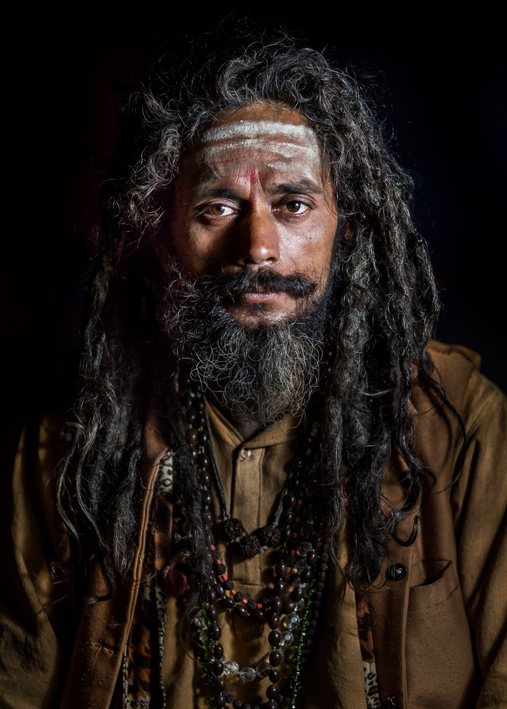 Following the path of liberation Sadhu wearing the hindu tripundra mark on his forehead.  He traveled fromSouth- India to the Far-West of Nepal to worship at the Godawari Shiva Ashram.