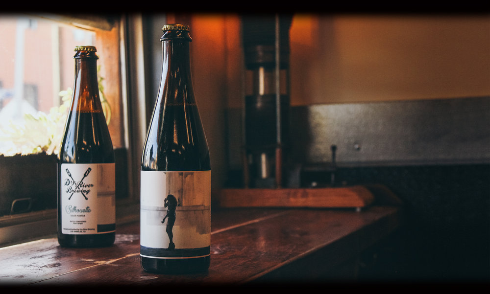 SILHOUETTE   ABV 7 | IBUS 25    RELEASED: PLACEMENT 2015   Our Sour Porter aged in Fresh KY Bourbon Barrels.   TASTING NOTES   Strong aromas of dark chocolate, sweet smoke, some vanilla, and dark berries. The acidity is modest compared to some of our other sours, which allows the rich grain notes to shine despite the dry finish.   OUR TAKE   One of our favorite beers to brew, not only because of the multitude of complex grains, but also because it means we have fresh bourbon barrels on the way!  PURCHASE BEER