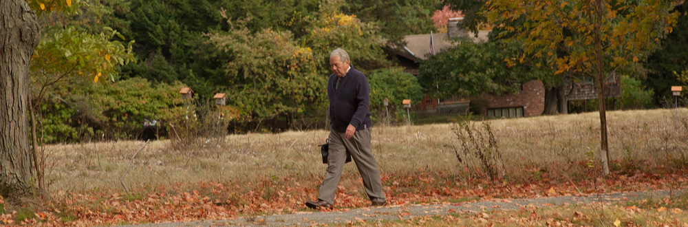 Dr. Brent Spears walks across a field.
