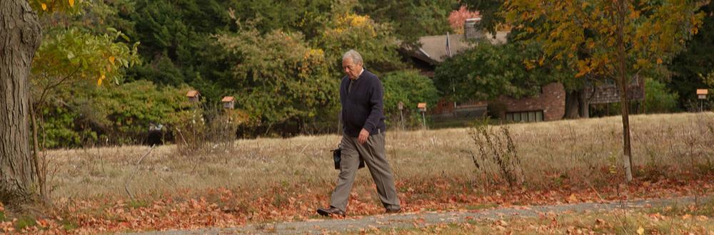 Dr. Brent Spears walks across a field.