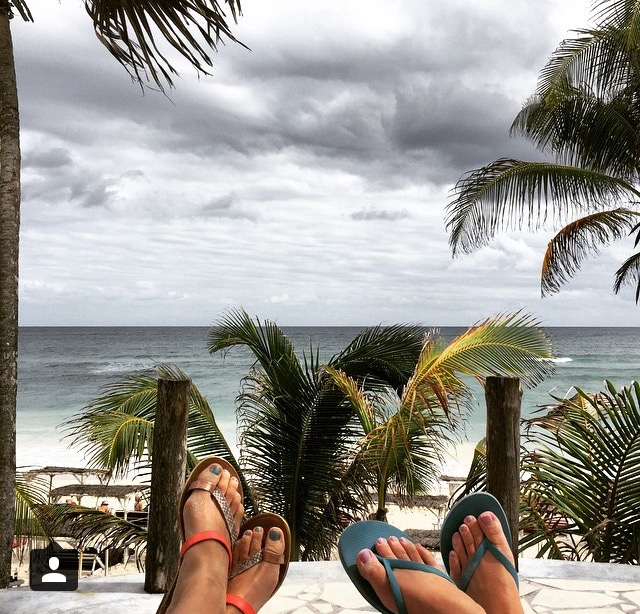 Andrea + Brandi's enjoying the view from their beachside bungalow in Tulum.