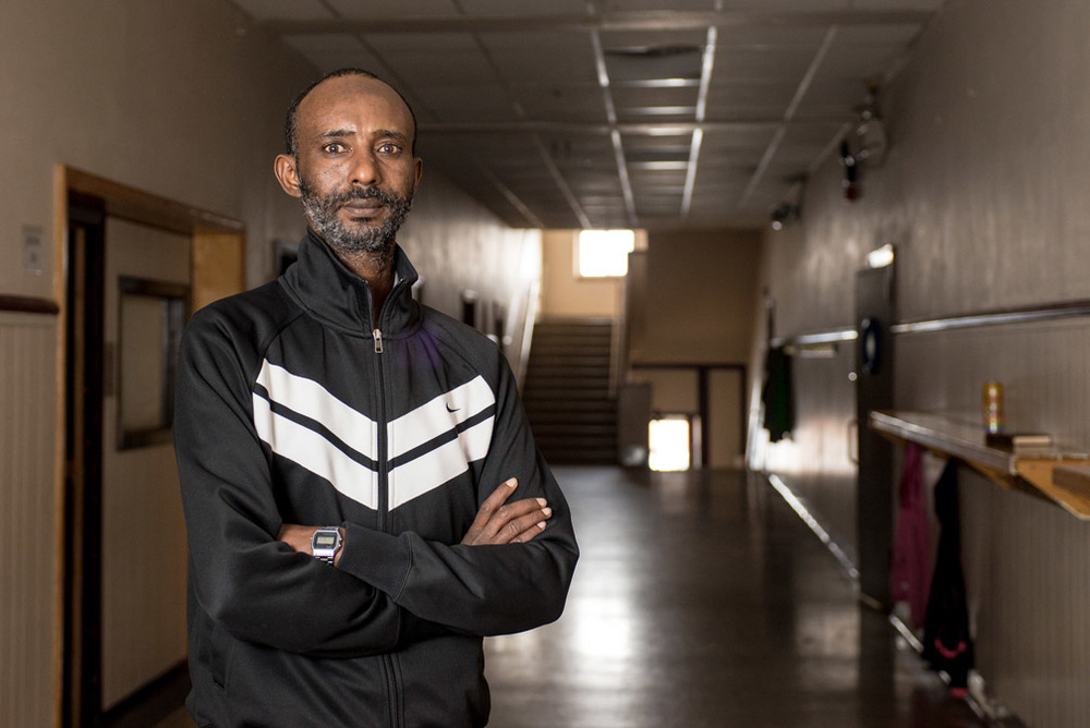 Mohamednour Aded, 38, poses for a photo in the hallway of former Garfield Elementary School, which is now a mosque that was started by the Islamic Center of St. Cloud in St. Cloud, Minn., Wednesday, Jan. 13, 2016. Aded came to the United States in 2013 and was injured while working at American Food Group. While working at American, Aded had to pray in the bathroom after he was denied to take prayer breaks.
