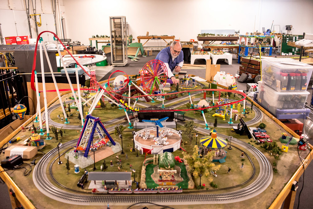 Peter Southard, a member and volunteer with Twin City Model Railroad Museum, works on preparing a carnival display as the museum approaches its re-opening set for mid-May at its new location in St. Paul, Minn., Saturday, April 2, 2016. The carnival display has multiple moving displays including a Ferris wheel, roller coaster, merry-go-round, and a mini drive-in movie theater with a screen that shows a live view from a camera mounted on the front of the model train running on the track. Southard, an associate professor in the operations and supply chain management department at the Opus College of Business at the University of St. Thomas, is an avid collector and model train enthusiast. He has been heavily involved in the moving of the museum from its former location at Bandana Square to Transfer Road in St. Paul, Minn.