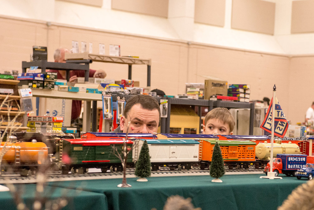 Todd Roach, left, and his son Brendan, 3, of Dellwood, Minn., watch model trains go by on a display at Upper Midwest Train Show and Sale at Century College in White Bear Lake, Minn., on Saturday, April 2, 2016. They were among hundreds of people that came out for the train show, which was a popular event for families, model train collectors, and railroad history enthusiasts.