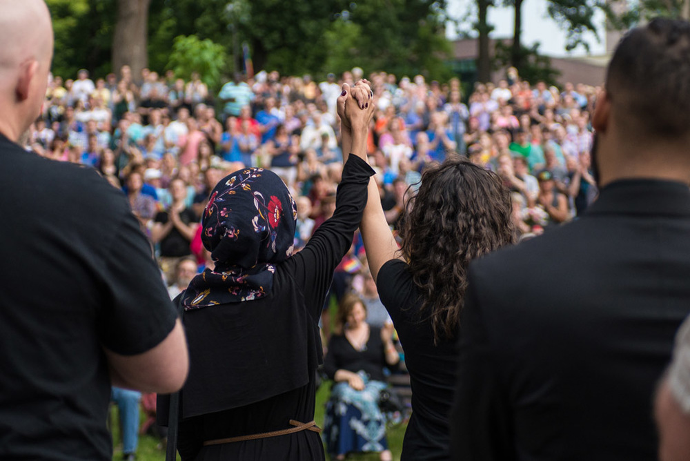 "Ilhan Omar, left, and Erin Maye Quade hold hands as Quade says, ""Hand in hand, we move forward,"" while speaking at the a vigil held for the victims of the shooting at Pulse nightclub in Orlando, Fla., at Loring Park in Minneapolis, Minn., Sunday, June 12, 2016."