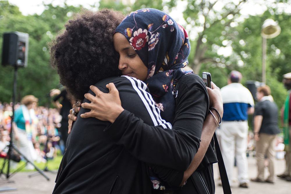 Ilhan Omar embraces a friend after she spoke at a vigil held for the victims of the shooting at Pulse nightclub in Orlando, Fla., at Loring Park in Minneapolis, Minn., Sunday, June 12, 2016. Omar is running for Minneapolis House District 60B and is a supporter of the GLBTQ community.