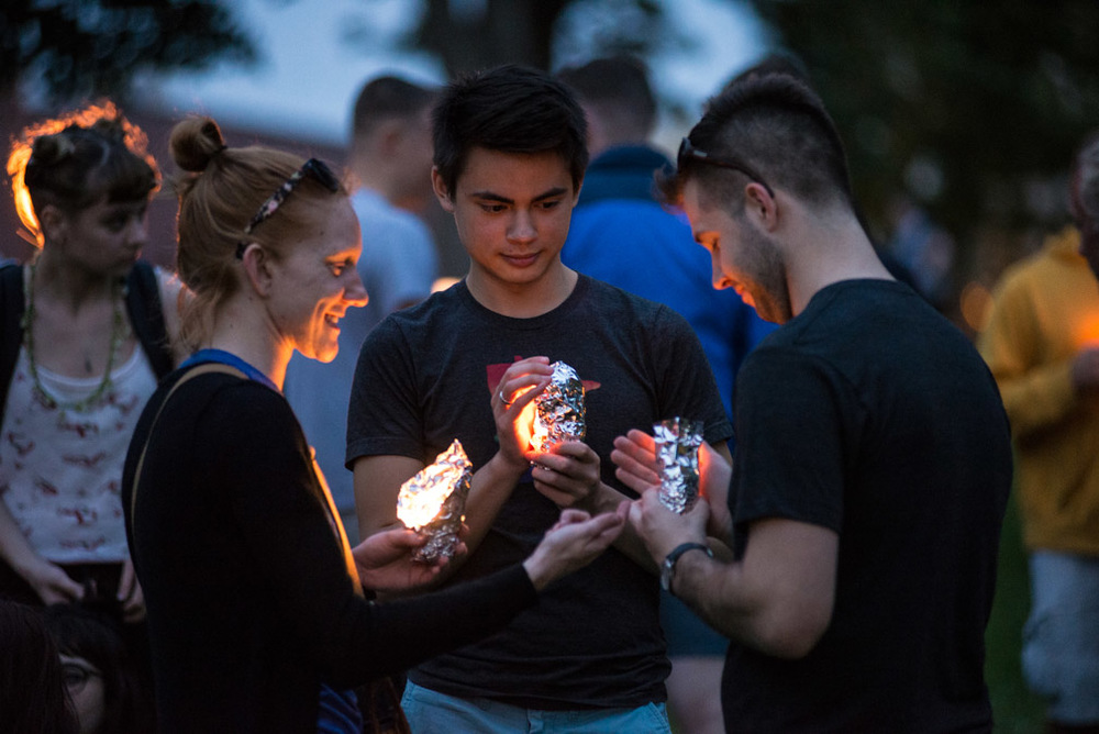 "From left, Laura Sanders, Jonathan Knudson, and Ethan Meyers hold candles they lit while attending a vigil held for the victims of the shooting at Pulse nightclub in Orlando, Fla., at Loring Park in Minneapolis, Minn., Sunday, June 12, 2016. ""We're fortunate to have a community here in Minneapolis that shows support for what happened,"" said Sanders."