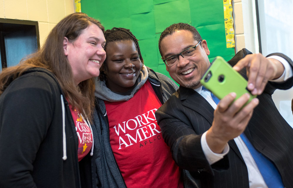 From left, organizers for Working America Alisa Tennessen and Tara Johnson, both from Minneapolis, take a selfie with U.S. Congressman Keith Ellison before the start of the Regional Worker Voice Summit at Dr. Martin Luther King, Jr. Recreation Center in Minneapolis, Minn., Tuesday, February 9, 2016. United States Secretary of Labor Tom Perez was the keynote speaker at the summit, and Johnson spoke on a panel after the summit concluded.
