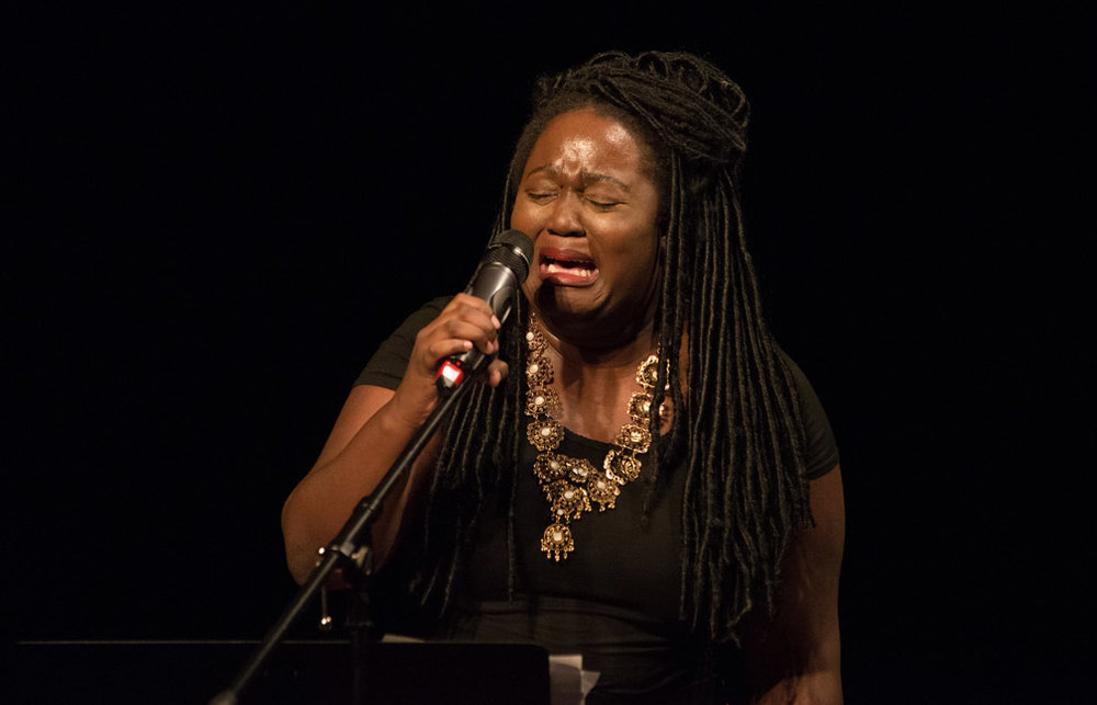 "Overcome with emotion, poet Ashley Oliver performs her poem ""Blank"" during Black Poets Speak Out at the Penumbra Theatre in St. Paul, Minn., Wednesday, July 13, 2016. ""And then there's John Crawford, 20 miles up the dusty Ohio roads that I call home,"" she recited. ""Wrongfully accused of brandishing a gun at customers, the police ran up behind him, he's on the phone, back turned, bullets shot, bullets shot, bullets continued to be shot, as his girlfriend and father are on speaker phone listening. Until the resounding shots stop. The cacophony ceases. And the airwaves went blank."""
