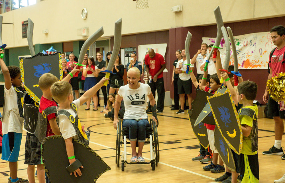 Paralympic swimmer Mallory Weggemann receives a sword salute at a sendoff celebration at Life Time Fitness in Lakeville, Minn., Thursday, Aug. 25, 2016. Weggemann will be competing at the 2016 Summer Paralympic Games in Rio de Janeiro, Brazil, and qualified to compete in seven events; the 400-meter freestyle, 100-meter breaststroke, 100-meter butterfly, 50-meter freestyle, 200-meter individual medley, 100-meter freestyle, and 100-meter backstroke. Only one other America Paralympic swimmer qualified in as many events as Weggemann.