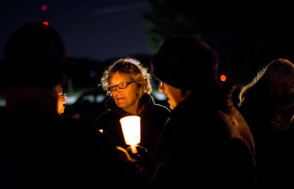 Supporters light candles as they gather for a vigil at the site where Philando Castile was shot and killed by St. Anthony police officer Jeronimo Yanez near the intersection of Larpenteur Avenue and Fry Street in Falcon Heights, Minn., three months after the incident on Friday, Oct. 7, 2016.