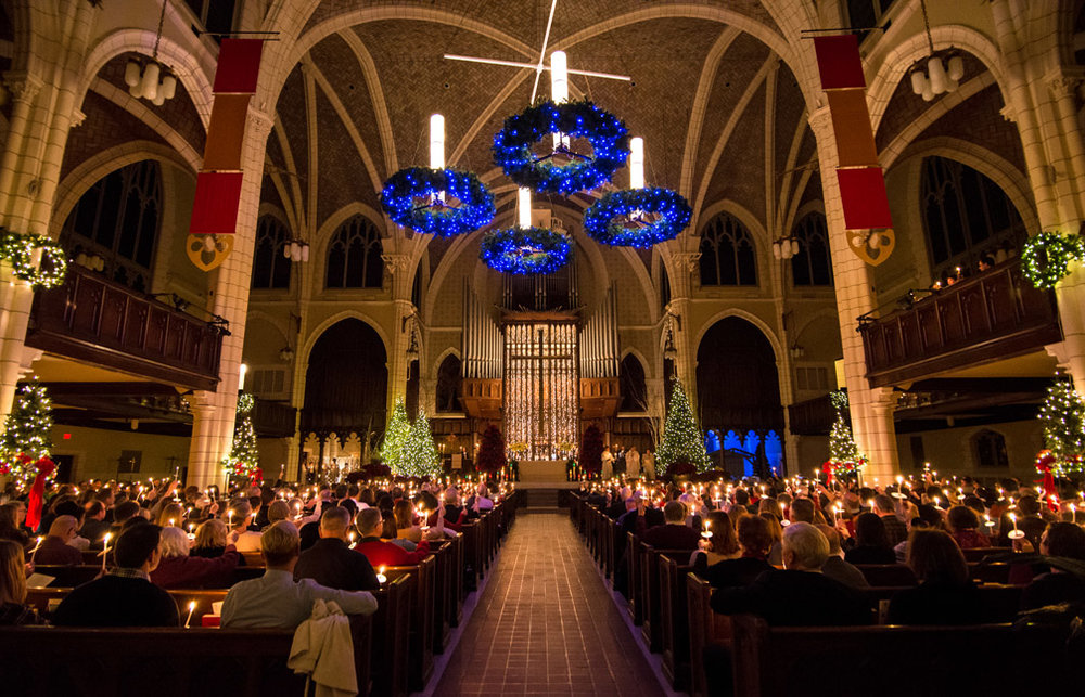 Parishioners light candles while attending Christmas Eve service at Central Lutheran Church in Minneapolis, Minn., on Saturday, December 24, 2016.
