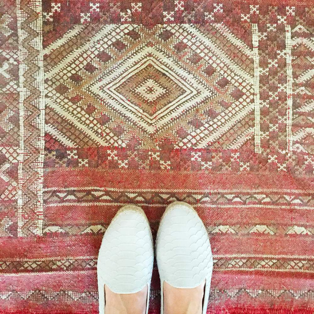 According to Hungarian tradition (my husband's roots), a bride and groom are to say their vows on a red cloth ( rushnyk ), which they then display in their home. We changed tradition slightly with this Moroccan rug from  Badia Design --it's a constant reminder of that most amazing day.