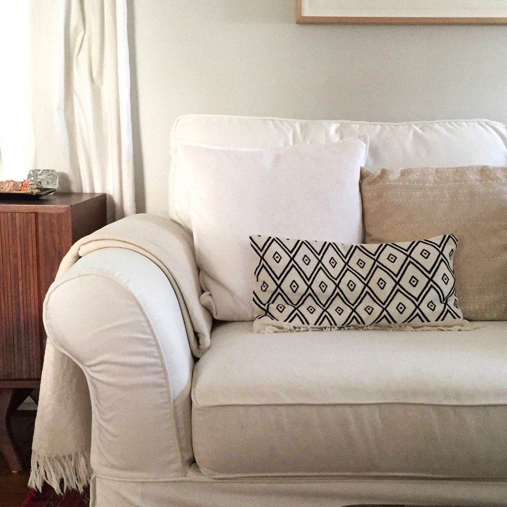 Another example of artisanal fabrics giving standard items an upgrade: For practicality's sake, we ended up with a very basic slipcovered couch from  Pottery Barn . It gains visual interest when topped with hand embroidered pillows and throws from Mexico.