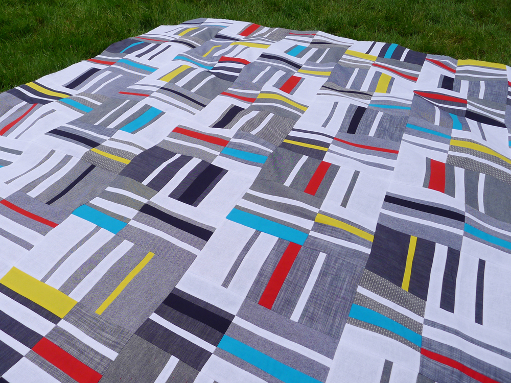 Detail of Knee Socks quilt by Elizabeth Hartman, featuring Robert Kaufman's Chambray Union and Kona Cotton.