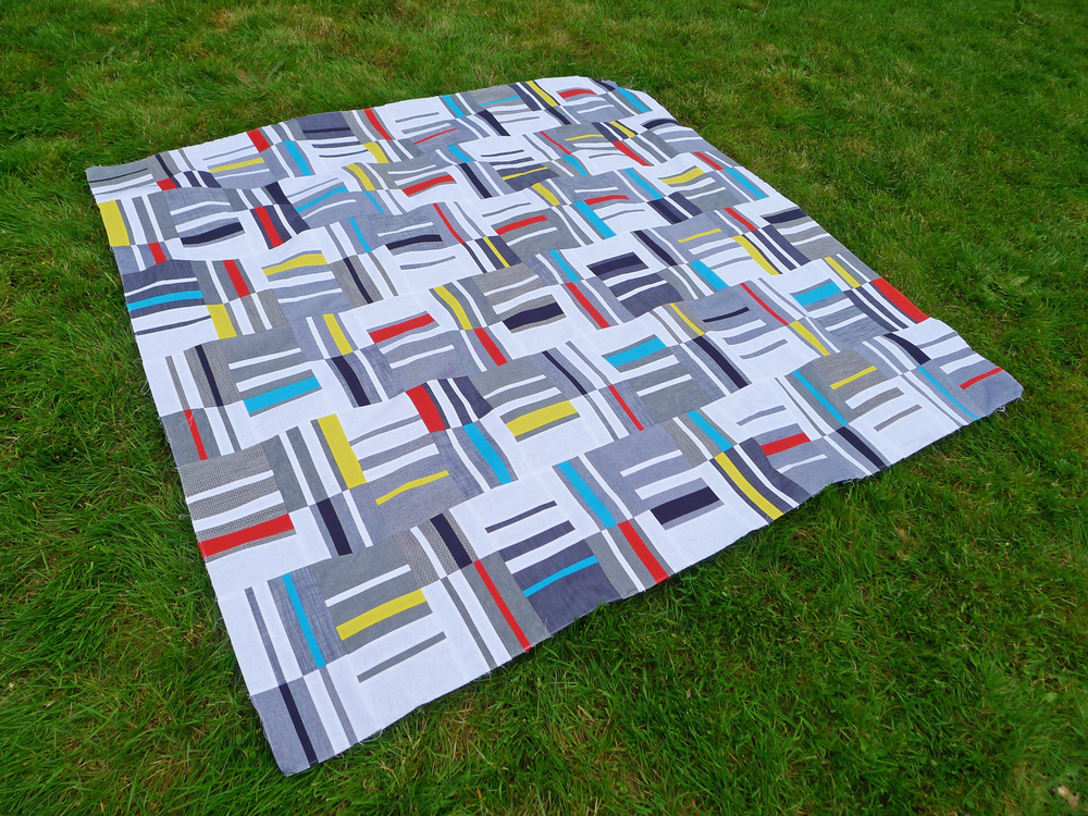 Knee Socks quilt top by Elizabeth Hartman, featuring Robert Kaufman's Chambray Union and Kona Cotton.