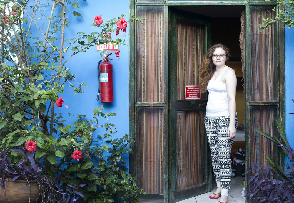 My friend Tori stepping out of the hostel room where six of us slept last night.