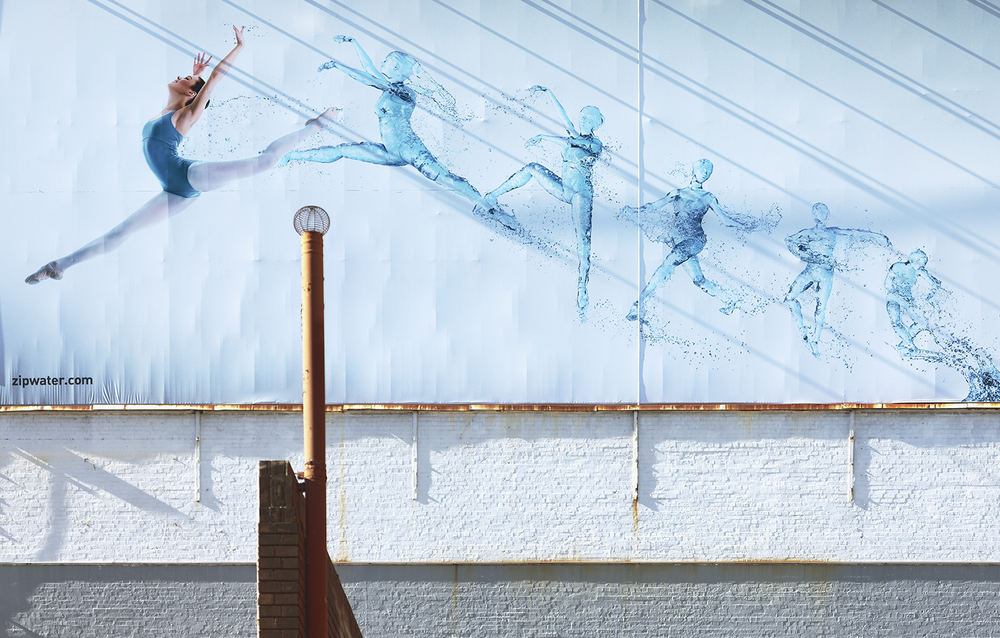 Zip Water Ballerina billboard perfectly captured on the street by photographer Marion Abada. See more of her work here.