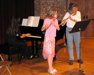Elizabeth (age 12) playing with her collegiate teacher, former New York Philharmonic Principal Flutist Jeanne Baxtresser.