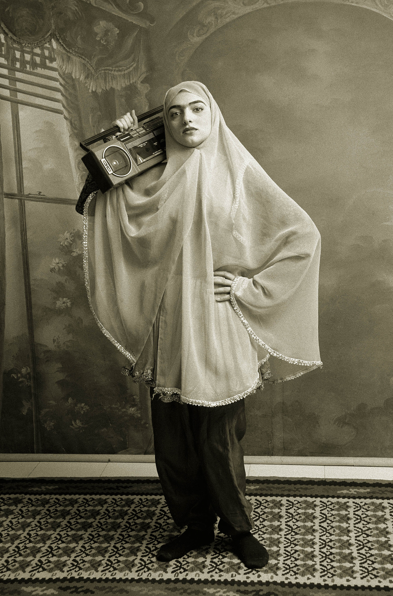 I love this photo because it show defiance against   oppression.      It shows a young woman posing with an object banned under the Iranian Revolution.           Ghadirian, S. (Photographer). (1998). Qajar 3 [Web Photo]. Retrieved from  http://www.wipnyc.org/blog/shadi-ghadirian
