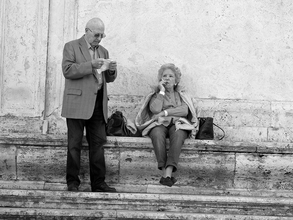Old couple on the stairs of Viktor Emanuel monument