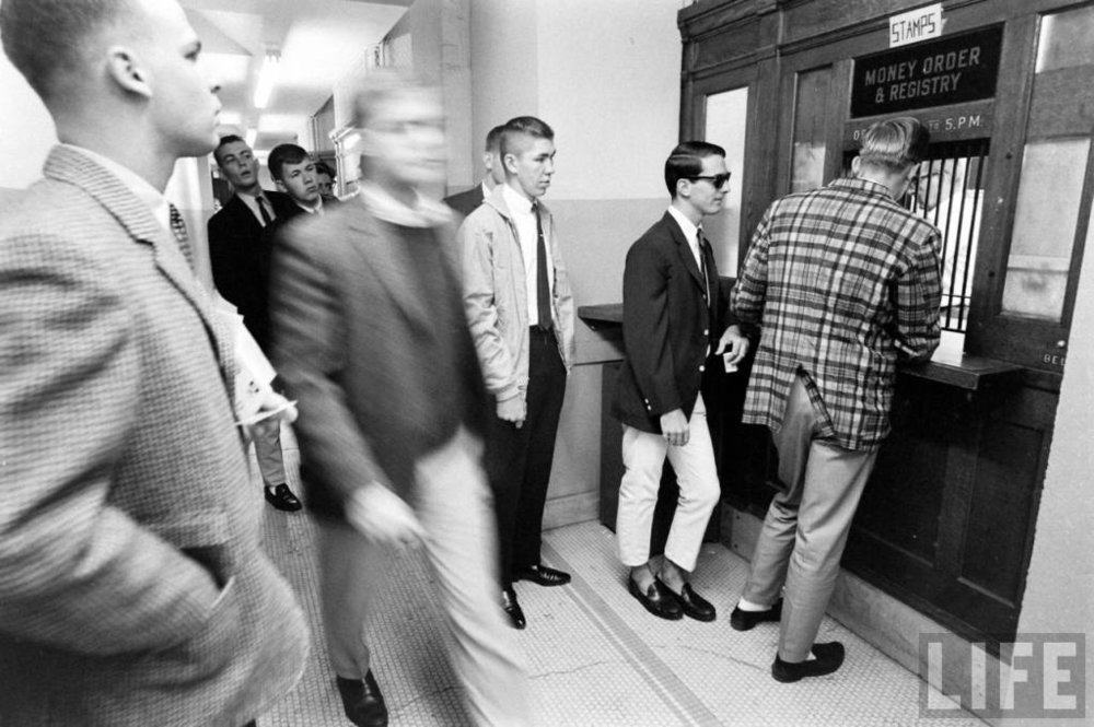 The famous photo of the 1964 Yalie with the blazer and shades, who is either wearing white chinos or extremely light khakis.