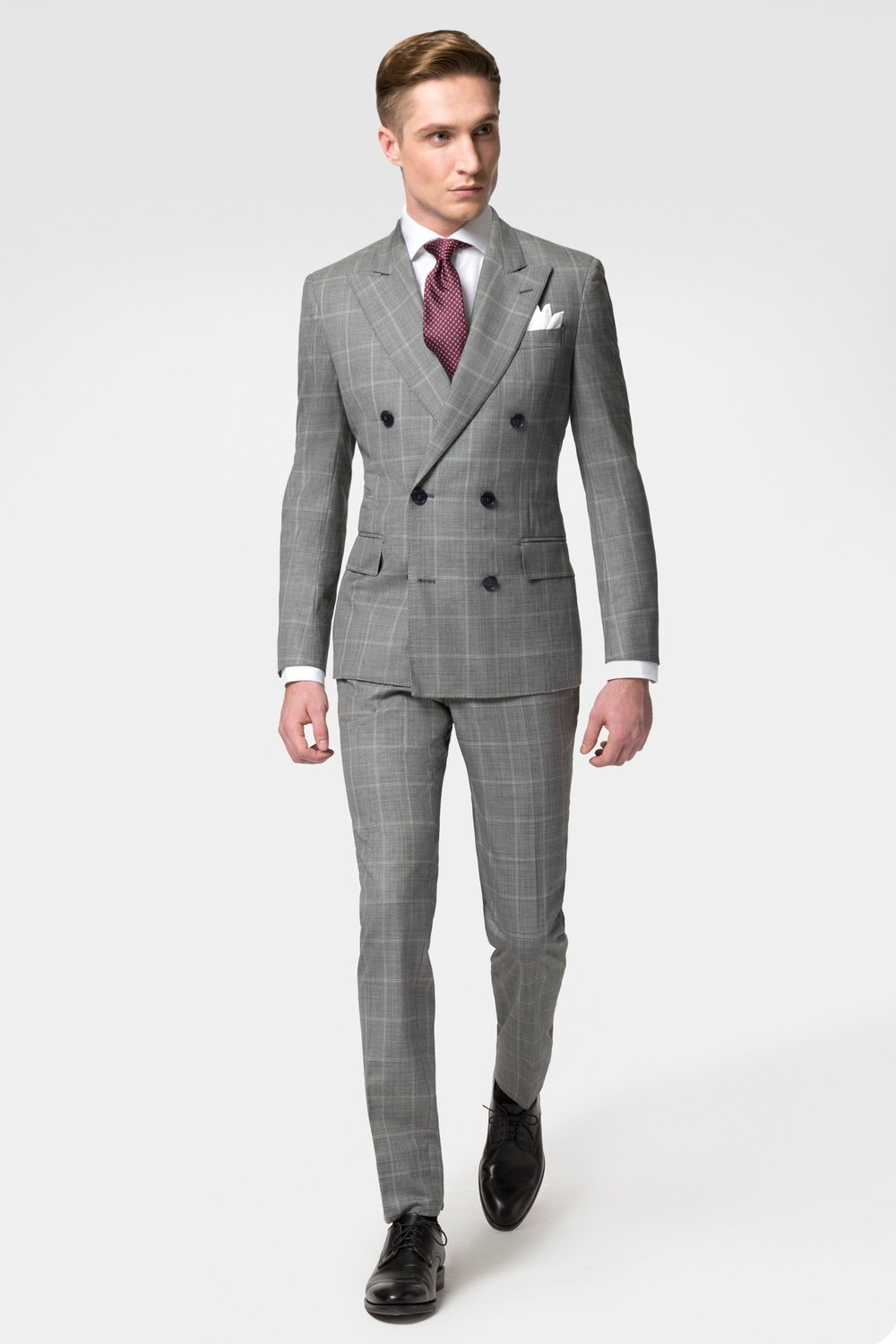 La mode savant  - An understanding of the basics goes a long way in making a unique office look. Watch for details and layers in this windowpane charcoal bespoke suit combo. We use  wardrobe essentials as accents to dress up this daily look.