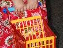 Abi's second favorite Christmas toy - a shopping cart.