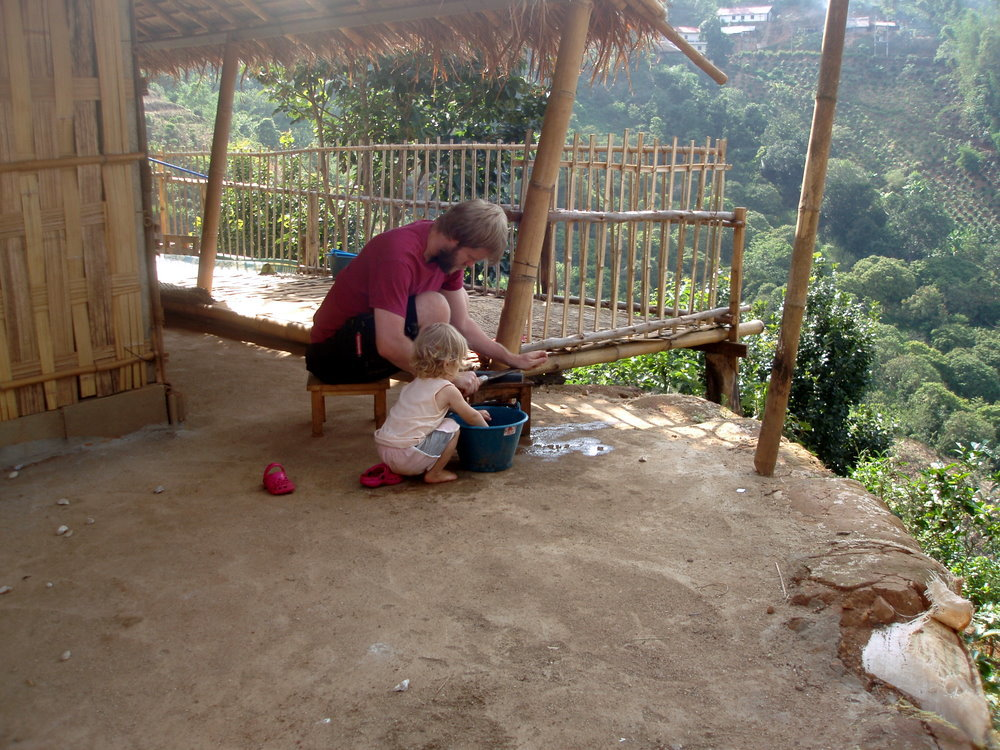 Paul & Abi sharpening the machete.