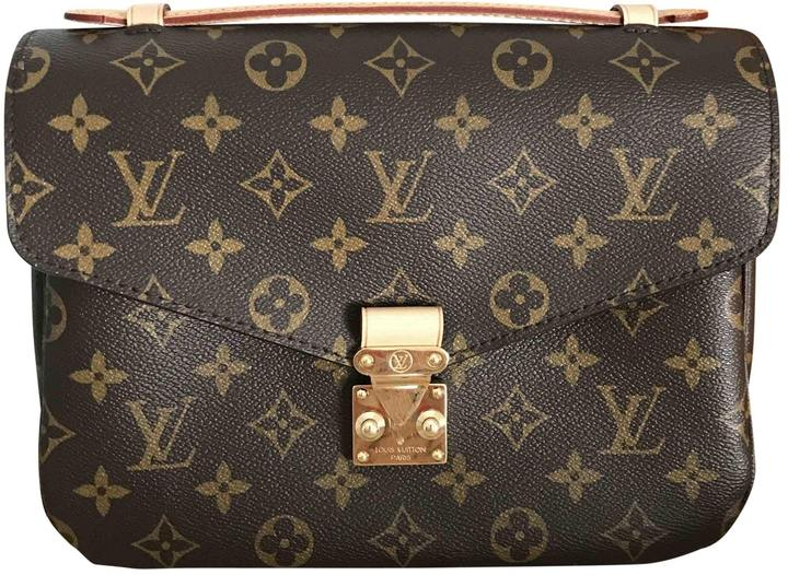 Louis Vuitton Metis Leather Handbag