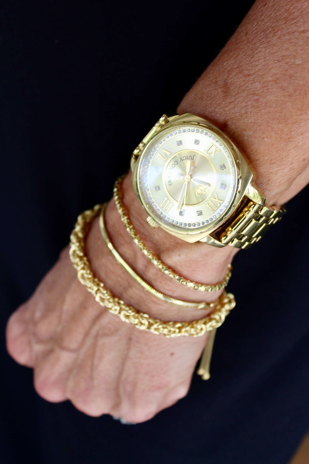 This photo features (from the bottom up) Goldtone Byzantine, Corcana and Margherita. and my personal gold watch!