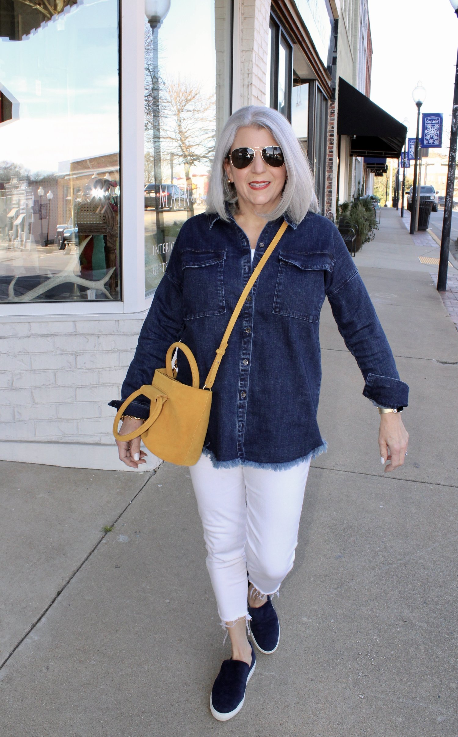 f4dded4823e I will be styling this fun find a number of ways… but love it with my white  jeans and a pop of color from my bag. I will be layering this over ...