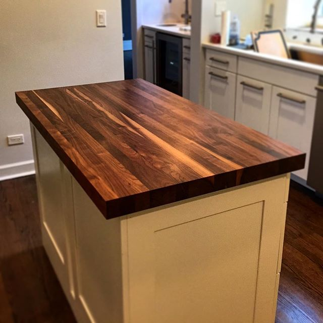 "3"" thick Black Walnut island w/continuous strips & clear satin polyurethane finish"
