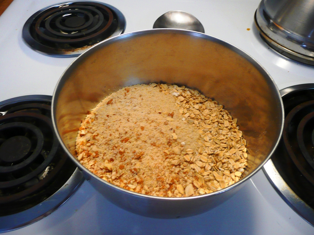 In a big mixing bowel put 1 1/2 cups of gluten free rolled oats and 3/4 cups chopped almonds and 3/4 cups chopped cashews