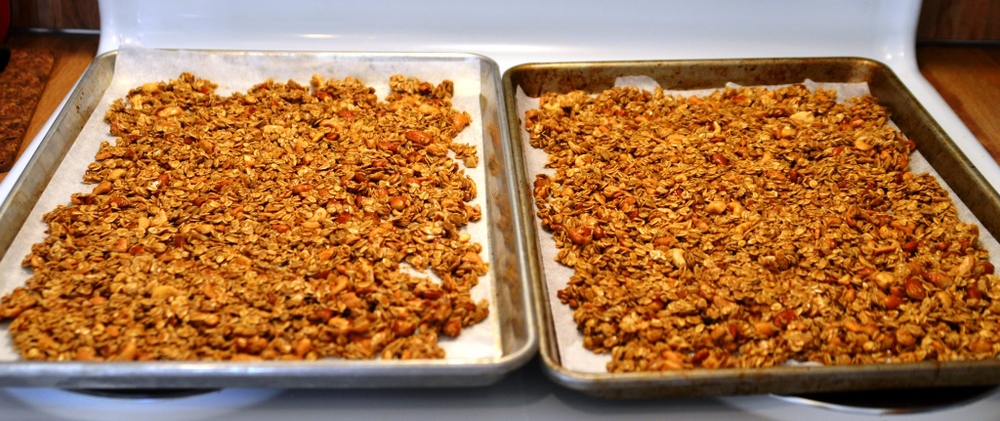 If you don't have two baking sheets that is ok! Just bake half at a time. This is also the first time that I used wax paper instead of my french silpat. Big Mistake!!! Once the granola cooled it just stuck onto the paper so bad that I had to re heat it to melt the butter and sugar. If you don't have a silpat I suggest you just scrape the granola in your container right away but the bad thing about that is it will all stick together in a big clump after cooling.