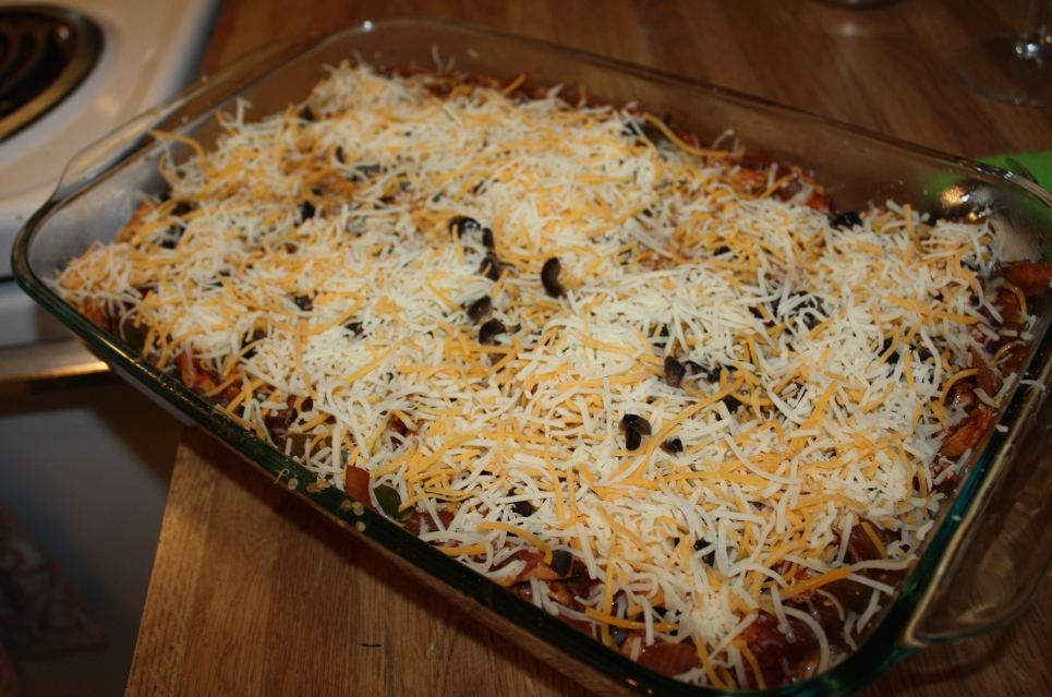 The top is just chopped black olives and plenty of shredded cheese.