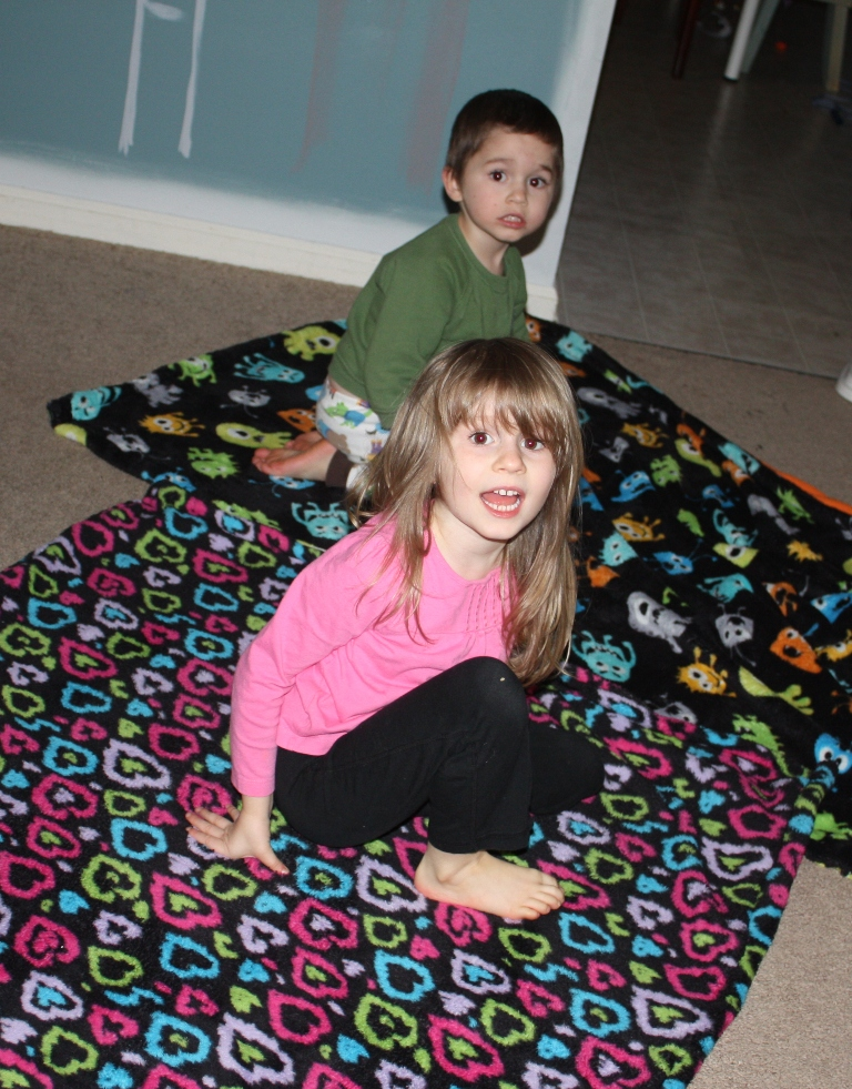 And that is it! My kids loved their blankets and here they are making 'ships' with them.