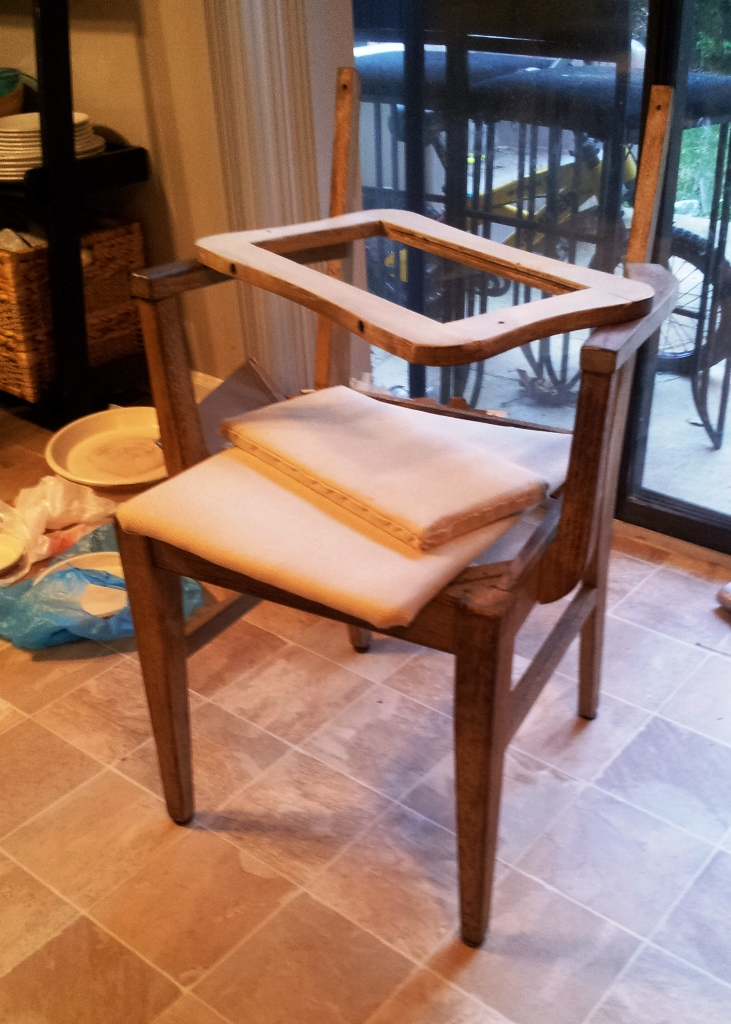 This chair was originally covered with a shaggy fabric, I changed it up with a woven cotton.