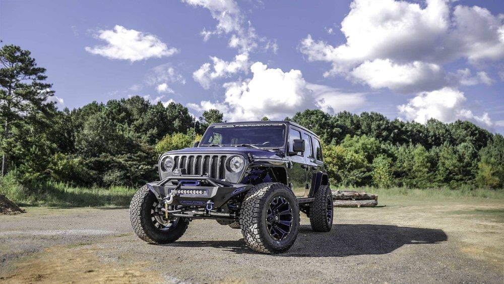 Jeep JL Black Widow Granite and Blue Front Qtr.jpg
