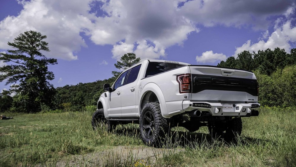 Ford Lifted Raptor White.jpg