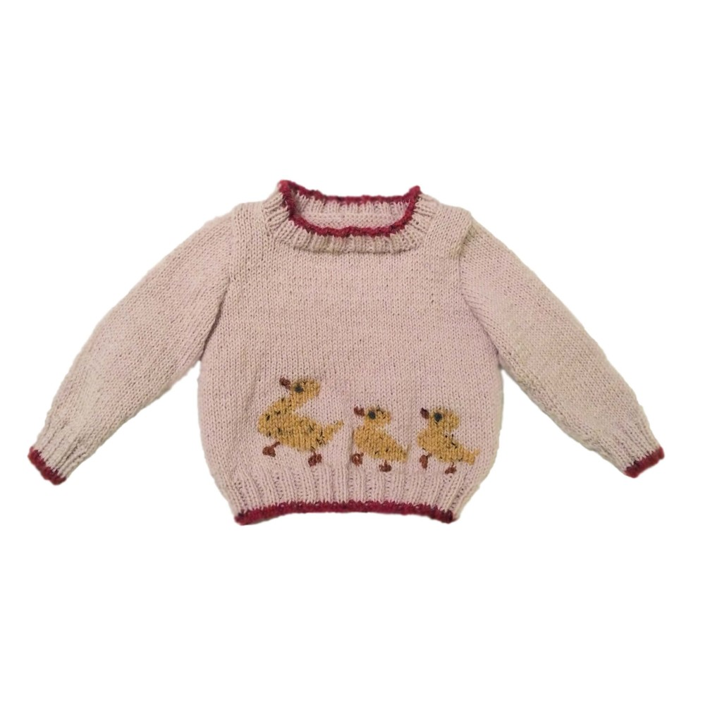 544abaad35f4 Learn the basics of sweater knitting while creating an adorable baby sweater.  The duckling motif is added after the sweater is put together using a ...