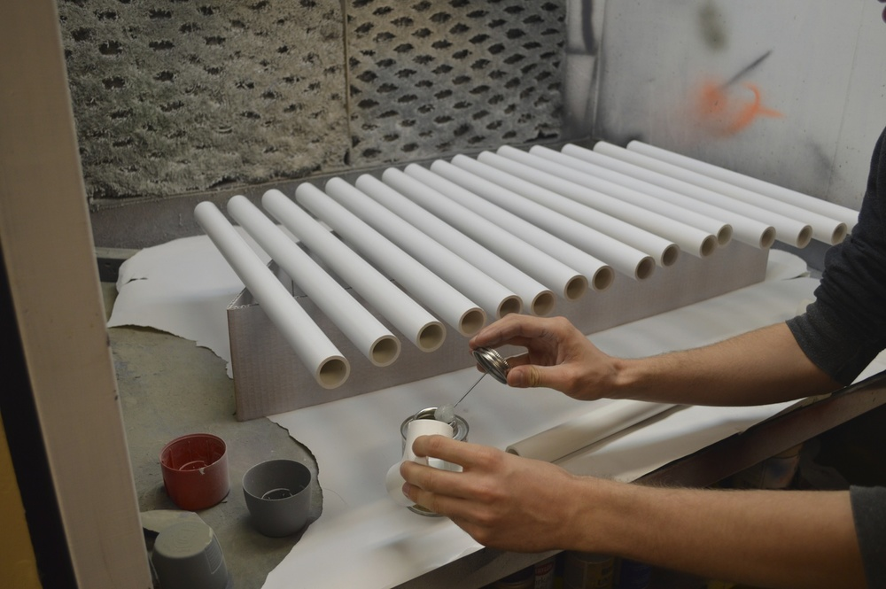 spray painting the PVC pipes