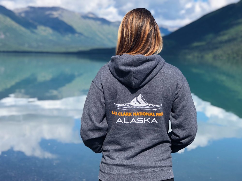 "Back of Tulchina Adventures Logo sweatshirt featuring ""Lake Clark National Park, Alaska"" with Original Artwork by Roan O'Neill @strongprettyboy_IG"
