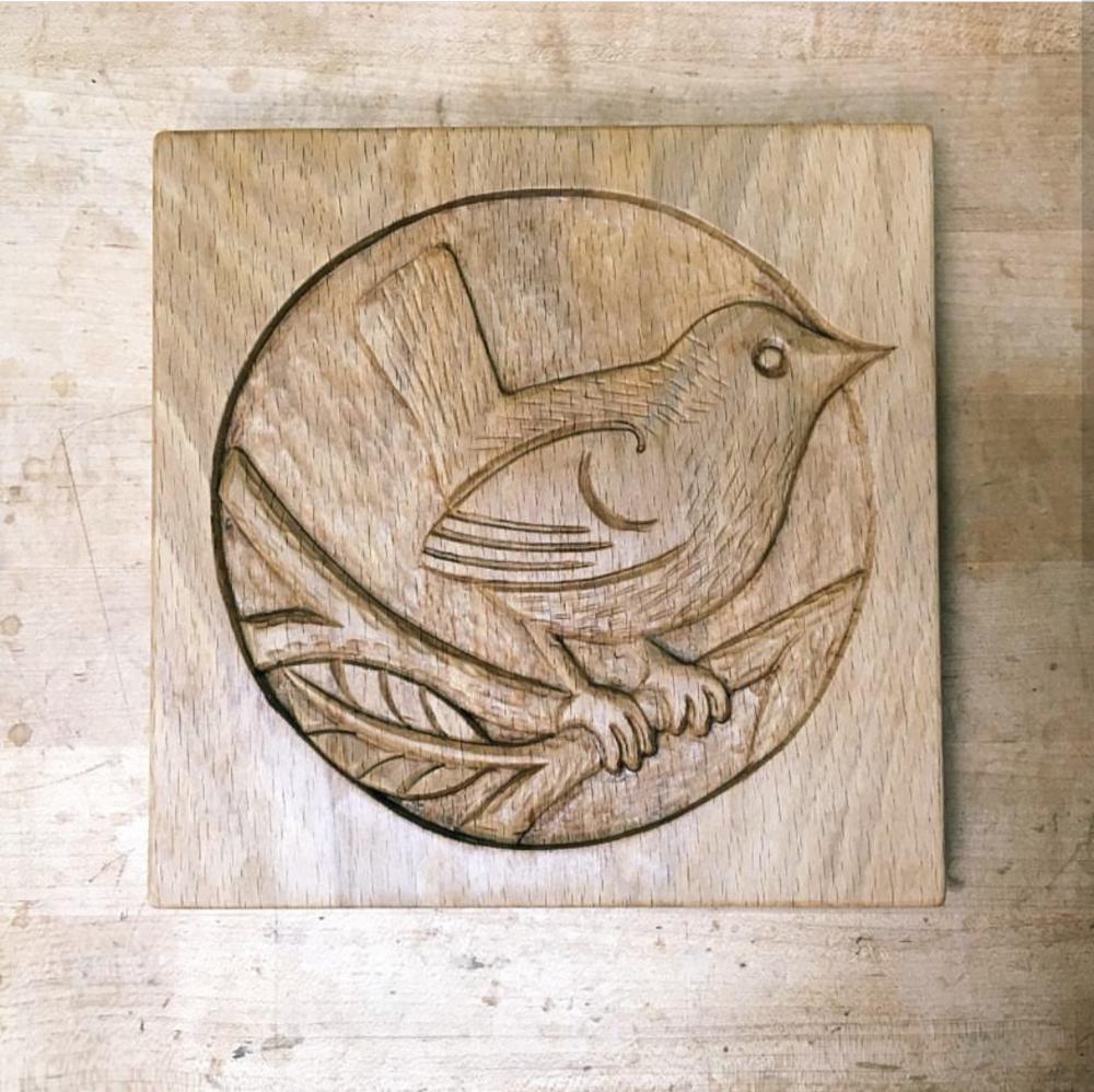 Wooden carved bird by Majid Lavansi