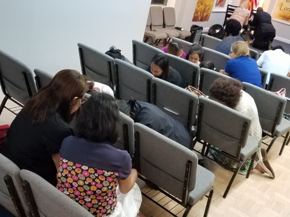 Regular church prayer meeting at midweek service (after preaching time). This is one side of the aisle.