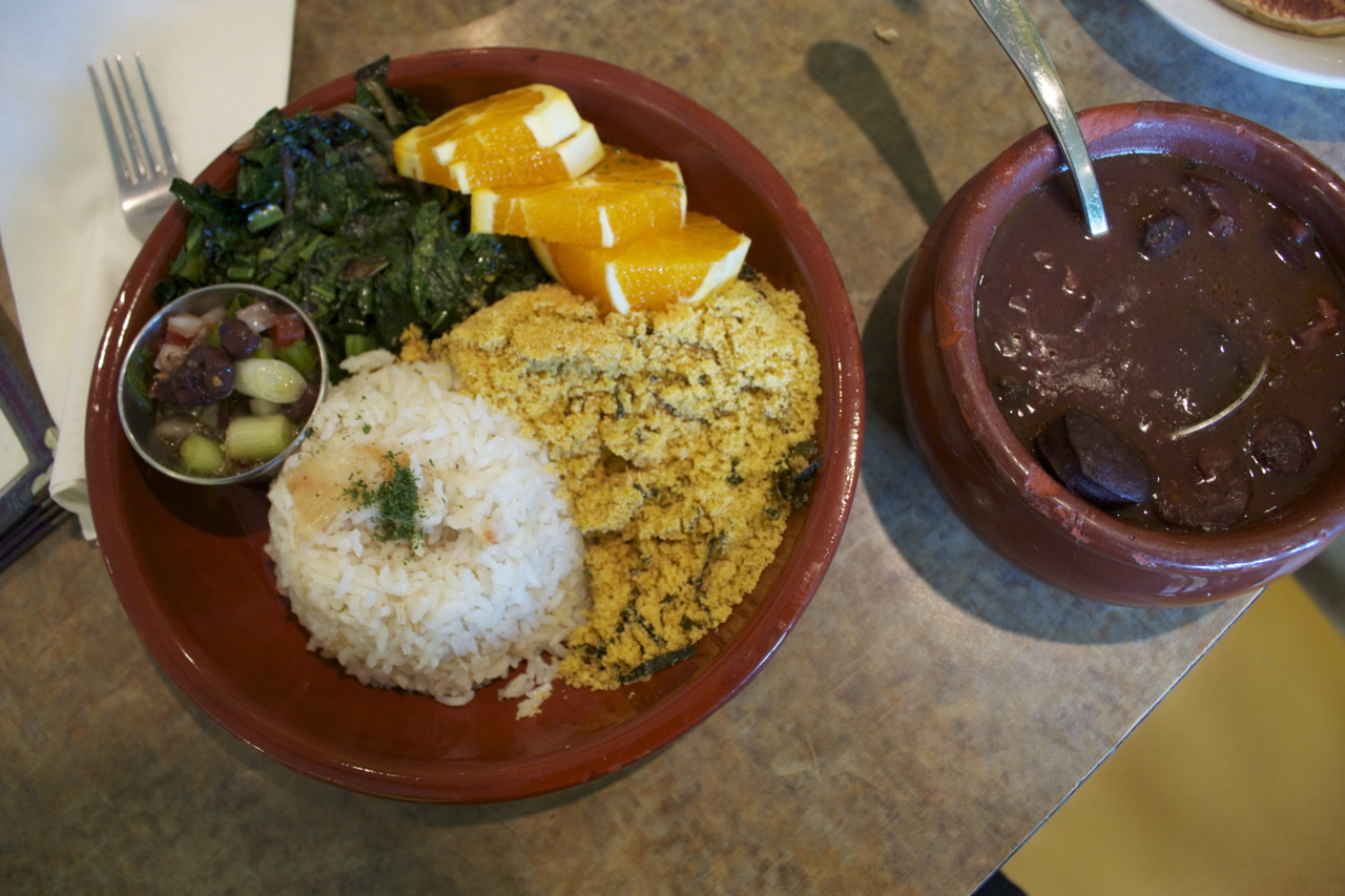 Feijoada Completa ( black bean stew simmered with various sausages served with rice, farofa, and sauteed greens)  @  Cafe Brasil  in Santa Cruz, CA
