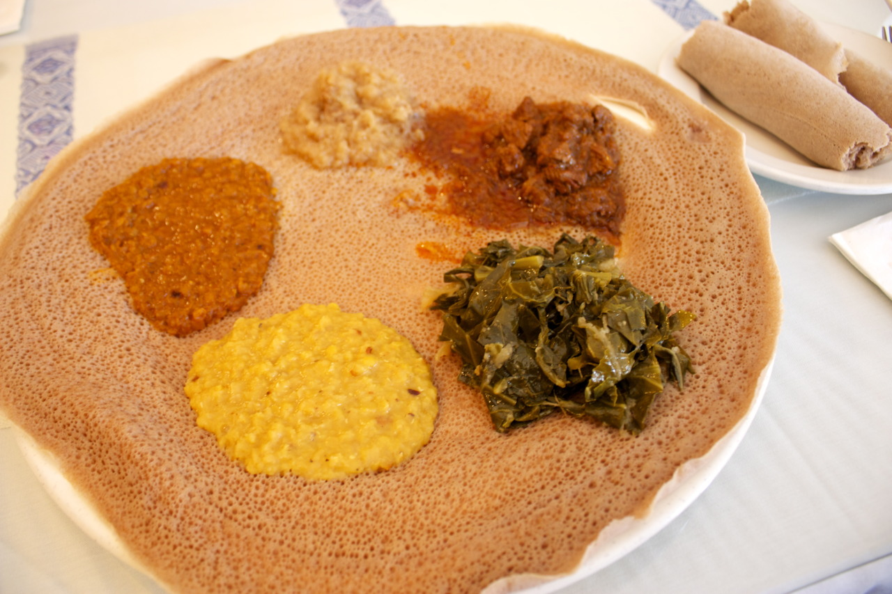 Meskerem Combo ( tibs wat, gomen besaega, miser alecha, and miser wat: beef tips, lamb, chick peas, lentils)  @ Meskerem in Myers Park, Charlotte, NC    The best thing about Ethiopian food: it's acceptable to eat with your hands!