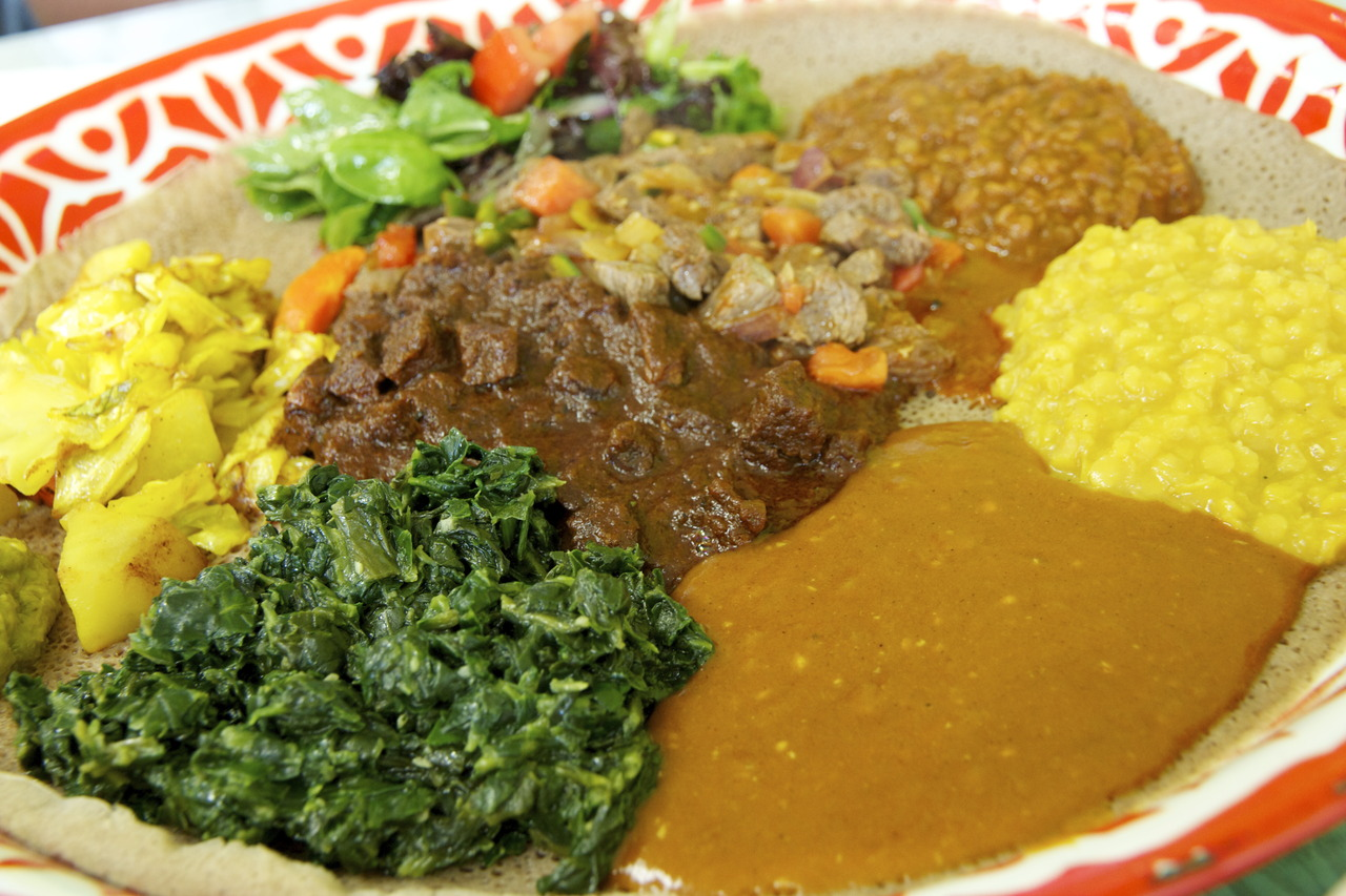 Meat Combination ( beef tibs, qey wot, and veggies ) @  Jebena Cafe  in Northgate - Seattle, WA    Amazing-tasting food for a great price!