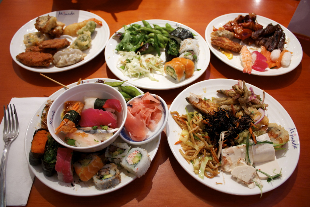 "Can one have way too much Japanese food?    I didn't think it was possible, but at  Minado … it is.    Minado is a special trip when you live in Boston: you have to drive 30 minutes out to get to Natick where the restaurant is located by the Natick mall (not IN the Natick mall). I rented a Zipcar just for the occasion and waited 35 minutes to be seated.    Honestly, I never enjoy buffets (which if I haven't mentioned yet - Minado is a ""Japanese Seafood"" buffet) simply because I can never get my money's worth and when food is mass-produced so quickly, quality tends to spin off. But I have to say, Minado was one of the more enjoyable buffets I have been to. They had good broccoli tempura, tasty side salads (seaweed salad nom!), and a really good green tea froyo machine! Unfortunately, the sushi was a complete miss, but what can you expect when you're standing in line watching a group of Mexicans hurry back and forth trying to make a spicy dragon roll, shrugs. (Not being racist or anything…) I don't like rolls, but if you can't get a roll right, a nigiri might be even harder.    I expected not to have great sushi, so it wasn't a major disappointment. With that said, Minado was actually above my expectations! Would I go back? I don't know… I stuffed myself until I was sick… (But I still left room for dessert.) Maybe if I am feeling adventurous enough - because going to Minado requires a steel stomach and an ambitious eating mindset."