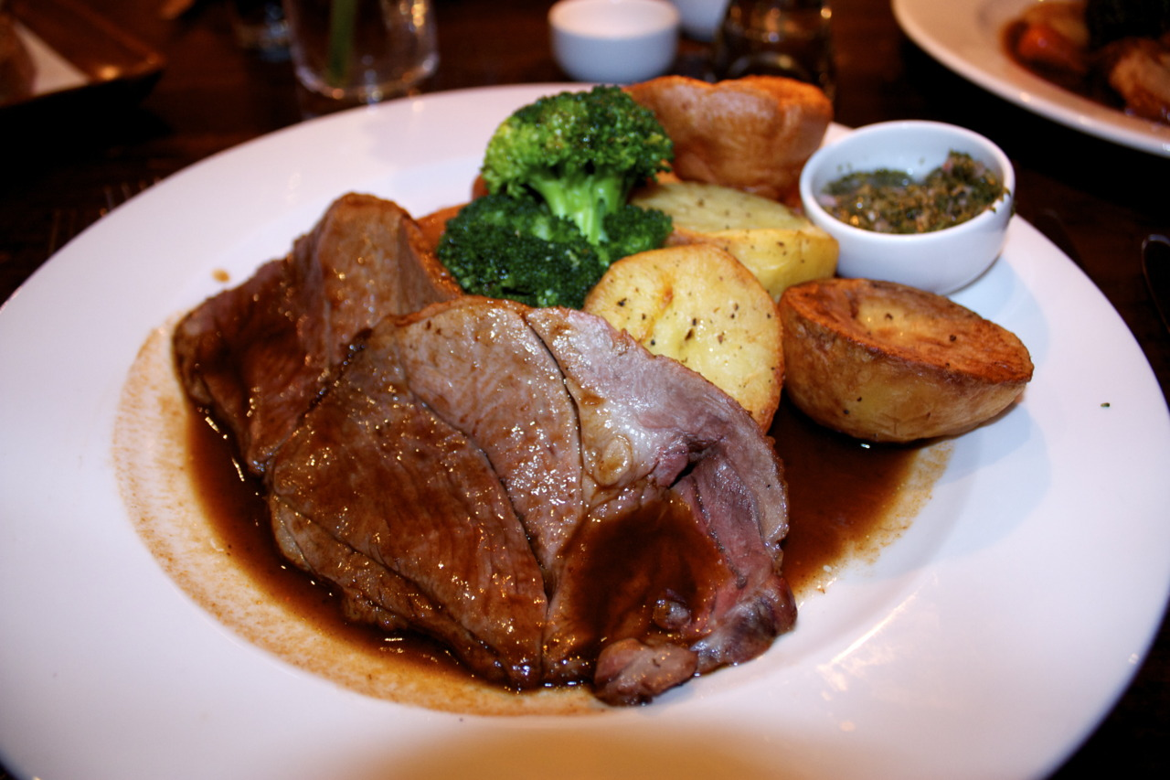 """Sunday Roast  Lamb with mint sauce @  White Horse Pub  on Parson's Green   On Sunday Roasts:   A telling observation by Henri Misson who staying in London in 1698 tells how """"it is a common practice, even among People of Good Substance, to have a huge Piece of Roast-Beef on Sundays, of which they stuff until they can swallow no more, and eat the rest cold, without any other Victuals, the other six Days of the Week"""".   Serfs could not always afford to have meat, so it would be a tradition for them to feast (or at least eat a bit more pleasantly) after church on Sundays."""